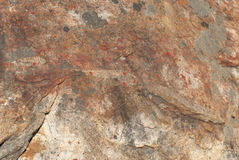 Brown rock with red spots background or texture. Brown rock with red spots to be used as background or texture. Geological formation Stock Images