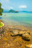 Brown rock seashore with turquoise color sea in Maak island in T. Rad province, Thailand Royalty Free Stock Photo