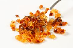 Brown rock sugar on spoon Royalty Free Stock Image