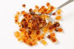 Brown rock sugar on spoon Royalty Free Stock Image