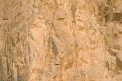 Brown rock texture. Stone background Stock Photos