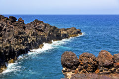 Brown rock in white coast lanzarote   spain   beach  stone water Stock Photos