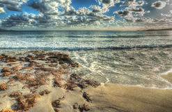 Brown rocks by Le Bombade shore Royalty Free Stock Photography
