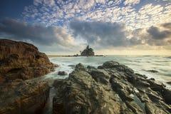 Brown Rocks on Seashore Under White Cloud Sky Royalty Free Stock Photo