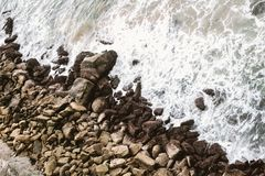 Brown Rocks On Shore Royalty Free Stock Photos