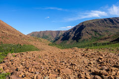 Brown rocky hills with scree slopes Royalty Free Stock Images