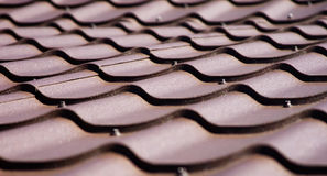 Brown roof of metal roofing Stock Images