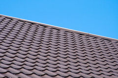 Brown roof of metal roofing on the sky background Royalty Free Stock Image