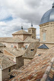 Brown roofs and tiles under the cloudy sky in Toledo. In Spain Stock Photos