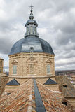 Brown roofs under the cloudy sky in Toledo Royalty Free Stock Image