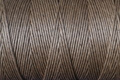 Brown rope. Rolled up brown rope background Royalty Free Stock Image