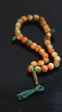 Brown rosary. Pic of brown rosary on black Royalty Free Stock Photo