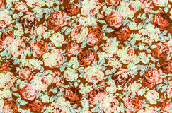 Brown rose fabric background, Fragment of colorful retro tapestr Royalty Free Stock Photo