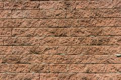 The brown rough brick wall. Background Stock Photo