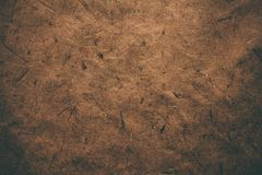 Brown rough vintage paper. Abstract background and texture for designers. Old vintage recycled paper. Dark rough vintage paper. Stock Photography