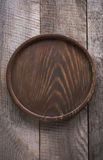 Brown round salver on wooden background. Top view. Royalty Free Stock Photography