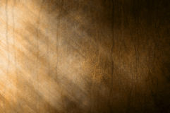 Brown Rust Abstract Background. An abstract brown background with dramatic lighting and rustic textures Stock Images