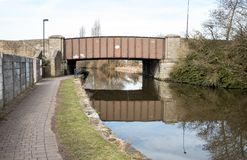 Brown Rusted Bridge. The brown rusted bridge that goes over the canal Royalty Free Stock Photos