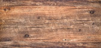 Brown rustic rough wood for backdrop. Wood texture background. Top view of dark vintage wooden table with a cracks. Brown rustic rough wood for backdrop. Surface royalty free stock photos