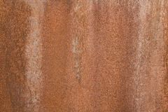 Brown rusty iron sheet with gray spots and dots. rough surface texture. A brown rusty iron sheet with gray spots and dots. rough surface texture royalty free stock photos