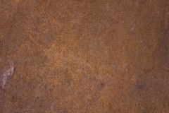 Brown rusty metal sheet with blue dots. rough surface texture. A brown rusty metal sheet with blue dots. rough surface texture stock image