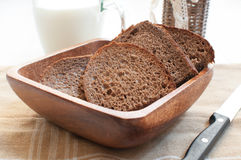 Brown rye bread slices with milk Stock Images