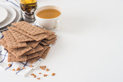 Brown rye crispy bread (Swedish crackers) on piece of cloth with Stock Images