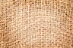 Brown sackcloth texture background with vintage grunge border Stock Images