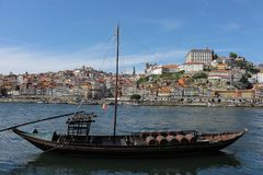 Brown sail boat with wine barrels in the Douro river in Porto, Portugal royalty free stock photo