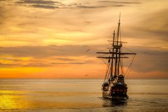 Brown Sailing Boat on the Sea during Sunset Stock Photography