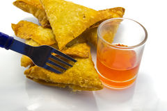 Brown samoosa and Chili sauce. Royalty Free Stock Photography