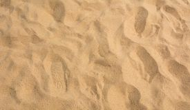 Brown sand at the beach There are traces of people walking. Royalty Free Stock Images