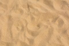 Brown sand at the beach There are traces of people walking. Royalty Free Stock Photo