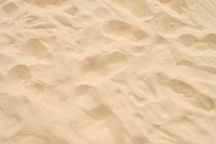 Brown sand at the beach There are traces of people walking. Stock Photography