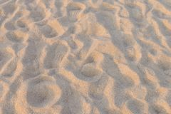 Brown sand at the beach There are traces of people walking Fine beach sand in the summer sun.  Royalty Free Stock Photography