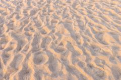 Brown sand at the beach There are traces of people walking Fine beach sand in the summer sun.  Stock Photography