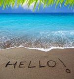 Brown sand beach with written word Hello Stock Photo