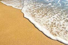 Brown Sand and Body of Water Royalty Free Stock Image