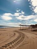 Brown Sand Near Seashore Under Cloudy Sky royalty free stock photo