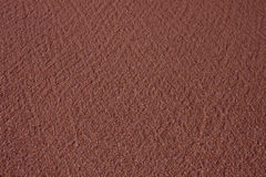 Brown sand texture. Dark brown smooth sand in thailand Royalty Free Stock Images