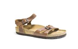 Brown, sandales en cuir de femme d'isolement sur le fond blanc photographie stock