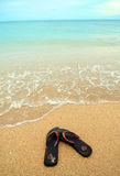 Brown sandals on the beach Royalty Free Stock Photo
