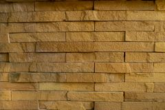 Brown brick wall background texture. Brown sandstone wall texture and background royalty free stock photo