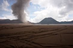 Brown sandy foot of the active Volcano mount Bromo early in the morning at the Tengger Semeru National Park. Stock Photos