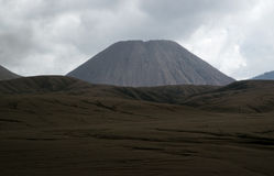 Brown sandy foot of mount Batok early in the afternoon at the Tengger Semeru National Park. Stock Photos