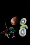 Brown Sapodilla Fruit Beside Red Cherry Fruit Stock Images