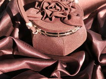 Brown satin and handbag Stock Photo