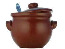 Brown saucepan from heatproof ceramics. Brown pot from heatproof ceramics with a spoon Stock Image