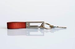 Brown-Schlüsselring- und -silberschlüssel Stockbild