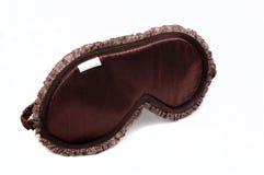 Brown-Schlafenmaske auf Weiß Lizenzfreie Stockbilder